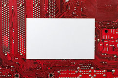 Red old dirty computer circuit board and place for text Royalty Free Stock Photo