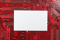 Red old dirty computer circuit board and place for text Stock Photography
