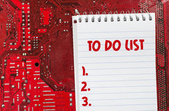 Red old dirty computer circuit board and to do list text concept Stock Images