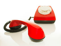 Red old fashioned telephone - Contact us concept Royalty Free Stock Image
