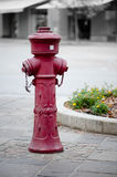 Red old fire hydrant in street. Stone pavement Royalty Free Stock Photo