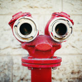 Red old fire hydrant on a street Royalty Free Stock Photography