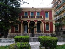 Red old house in Corfu island Greece. In garitsa area Stock Images