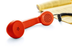 Red old phone and phone directory Stock Photos