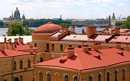 Red old roof. Russia. St. Petersburg. Scenic view on top of colorful roofs of the city Stock Image
