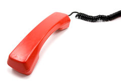 Red old scratched telephone receiver Stock Image