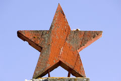 Red old star. Red old, rusty conrete star Stock Images