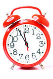 Red old style alarm clock isolated Royalty Free Stock Photos