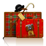 Red old suitcases with walking stick, bowler hat and retro photo Stock Photos