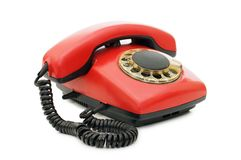 Red old telephone over white Royalty Free Stock Photos
