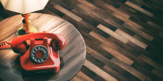 Red old telephone on wooden background. 3d illustration Stock Image