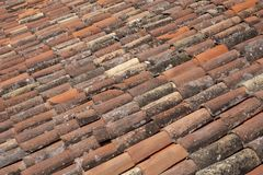 Red and old tiles on a roof stock photography