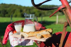 Tractor with milk and bread Royalty Free Stock Image