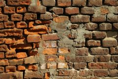 Red old worn brick wall texture background. Cracked brick wall. stock image