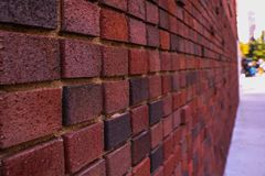 Red old worn brick wall texture background. Vintage effect royalty free stock photos