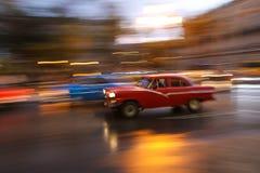 Red oldtimer car running in Havana street, Cuba. Shiny Red oldtimer car running in Havana street, Cuba Stock Images