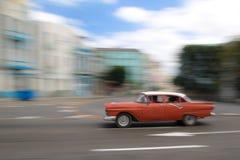 Red oldtimer car running in Havana street, Cuba Stock Image