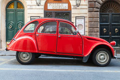 Red oltimer Citroen 2cv6 Special car, side view. Rome, Italy - August 9, 2015: Red oltimer Citroen 2cv6 Special car stands parked on the city roadside, side view Stock Photo