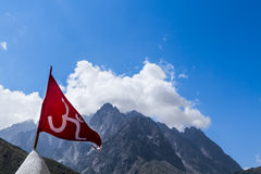 Red Om Flag in the Indian Himalayas Stock Photos