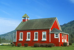 Red, one-room schoolhouse, Stone Lagoon on PCH,  Northern CA Royalty Free Stock Image