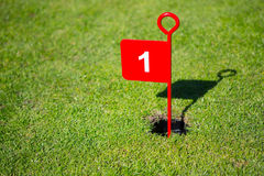 Red 1 one 1st  hole golf flag Royalty Free Stock Photos