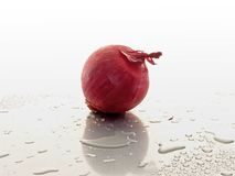 Red Onion. On Metal table Royalty Free Stock Image