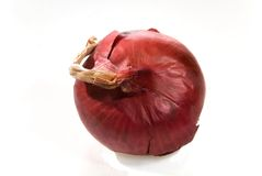 Red Onion. A red onion on a white background Royalty Free Stock Photography