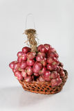 Red Onion on the basket Royalty Free Stock Photos