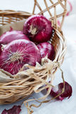 Red onion in a basket Stock Photo