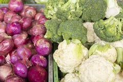 Red onion, broccoli and cauliflower in the market. Close-up food vegetarian organic fresh healthy agriculture cabbage background vitamin natural diet green stock photos