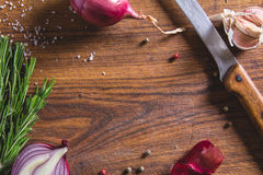 Red onion bulb on brown cutting board. Stock Photography