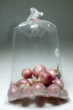 Red onion bulb in plastic bag Royalty Free Stock Photo