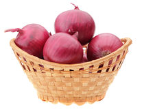 Red onion bulbs in basket Stock Photo