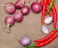 Red onion and chili on wooden table Stock Image