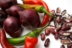 Red onion, chilli pepper and haricot beans, close- Stock Photos
