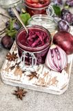 Red onion confiture spices Vegetable jam Plum marmalade. Red onion confiture with spices. Vegetable jam. Plum marmalade. Preserving ingredients Stock Image