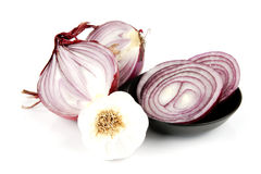 Red Onion Cut in Half with Garlic Royalty Free Stock Images