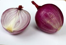 Red onion cut in half Royalty Free Stock Photography