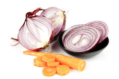 Red Onion Cut in Half with Slices and Carrot Royalty Free Stock Image