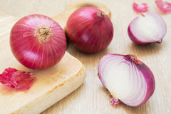 Red onion with cutting board Stock Image