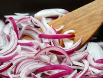 Red onion fried in a pan Royalty Free Stock Image