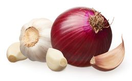 Red onion and garlic with cloves isolated on white stock photography
