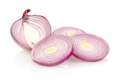 Red Onion Half and Slices on White Background Royalty Free Stock Image