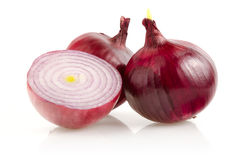 Red Onion with Half on White Background Royalty Free Stock Photography