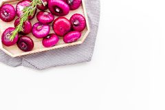 Red onion is healthy product. Onion bulbs in tray on white background top view space for text. Red onion is healthy product. Onion bulbs in tray on white Royalty Free Stock Photos