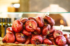 Red onion are heaped. On the counter Stock Images