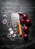 Red onion with an old hatchet. Stock Images