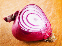 Red onion over chopping board Stock Photo