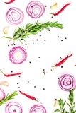 Red onion rings as seasoning. Onion near chili peper, rosemary, black peper, garlic on white background top view.  Stock Photography