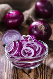 Red Onion Rings. (close-up shot) on rustic wooden background Royalty Free Stock Photos